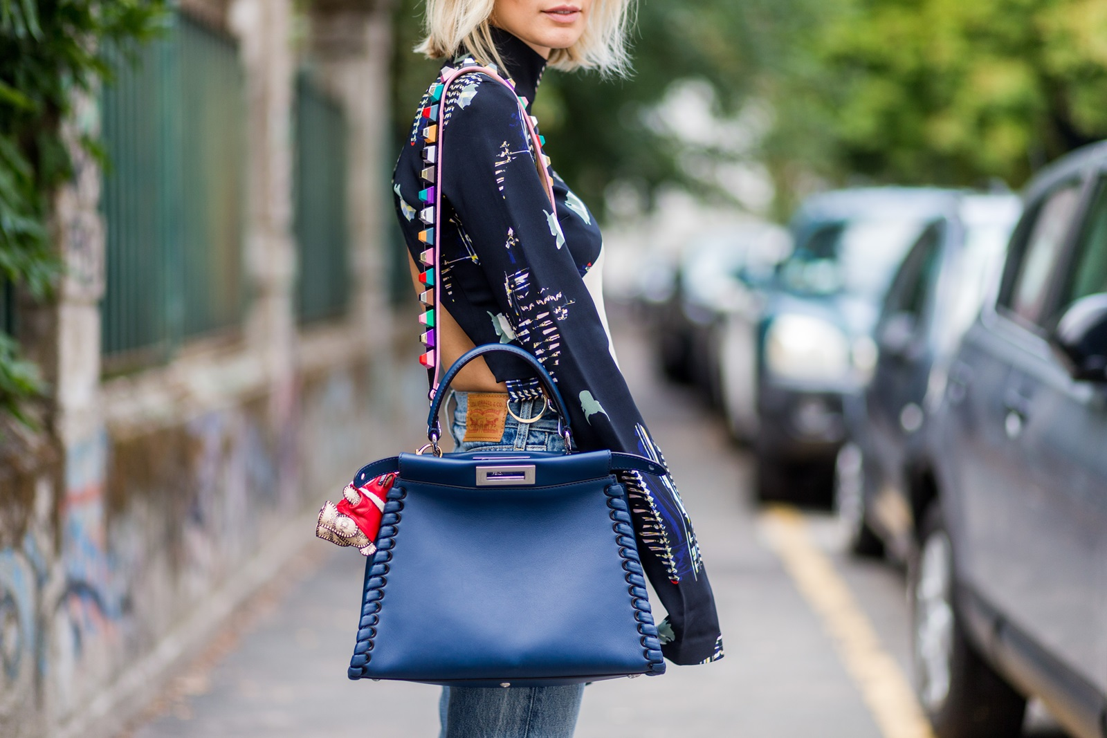 MILAN, ITALY - SEPTEMBER 22: Lisa Hahnbeuck (@lisarvd) wearing Lala Berlin Backless Cropped Silk Top with Long Sleeves, jeans Levi's Wedgie, bag Fendi Peekaboo outside Fendi during Milan Fashion Week Spring/Summer 2017 on September 22, 2016 in Milan, Italy. (Photo by Christian Vierig/Getty Images) *** Local Caption *** Lisa Hahnbeuck