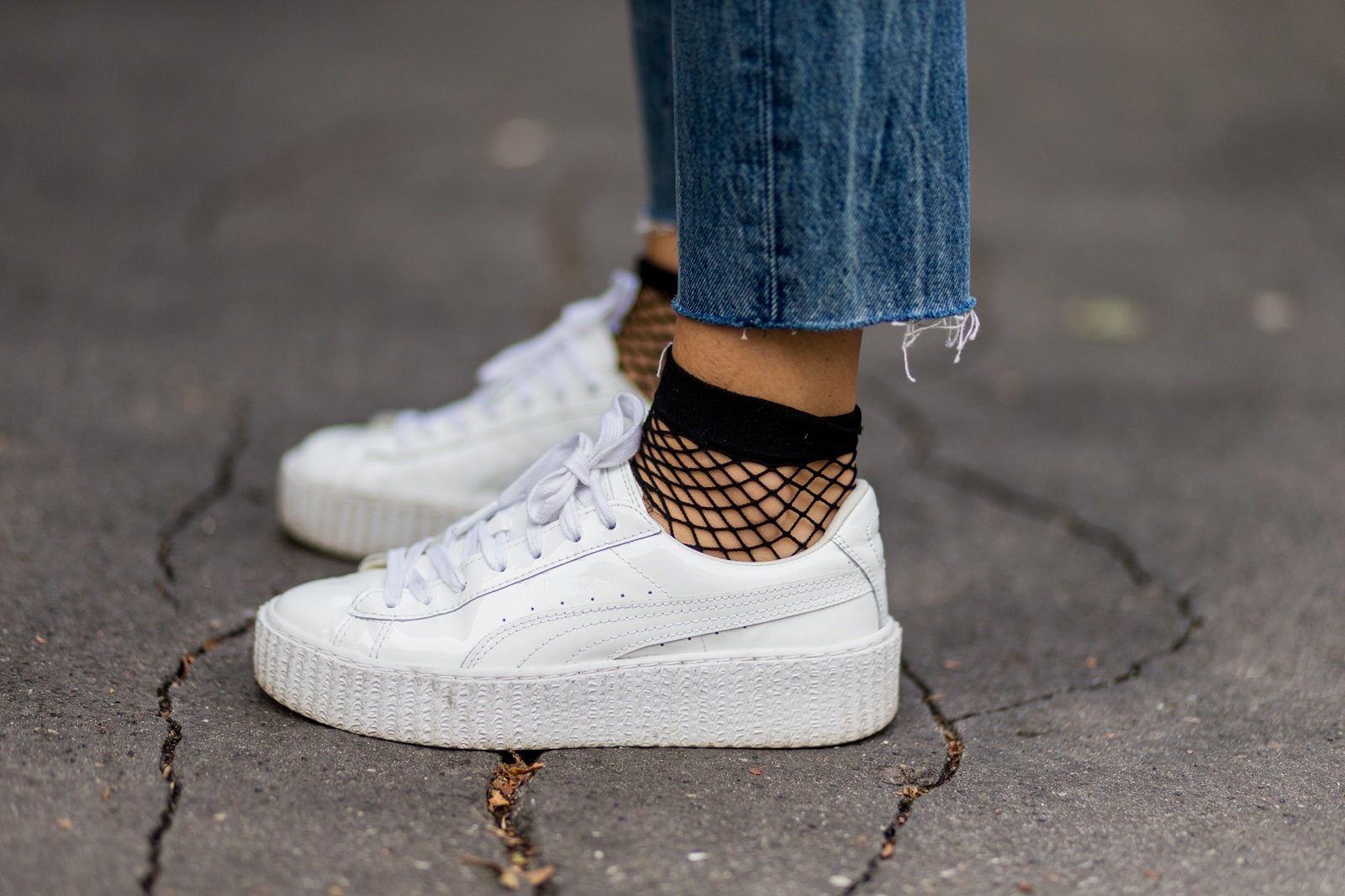 MILAN, ITALY - SEPTEMBER 22: Lisa Hahnbeuck (@lisarvd) wearing Puma Fenty Creeper Sneaker, Fishnet Socks Asos, outside Fendi during Milan Fashion Week Spring/Summer 2017 on September 22, 2016 in Milan, Italy. (Photo by Christian Vierig/Getty Images) *** Local Caption *** Lisa Hahnbeuck