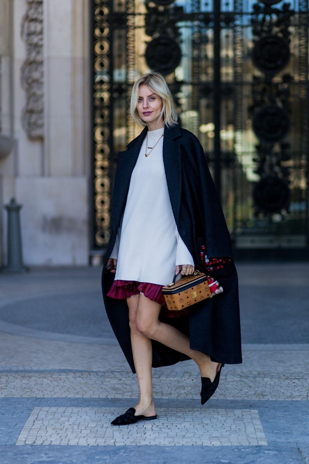 PARIS, FRANCE - OCTOBER 04: German fashion blogger Lisa Hahnbueck (@lisarvd) wearing Anya Hindmarch Oversize Coat, H&M Trend Knitdress, Storets Metallic Plissee Skirt, Alberta Ferretti Velvet & Embroidered Flats, MCM Rockstar Beautycase MCM Teddy Bear Charm on October 4, 2016 in Paris, France. (Photo by Christian Vierig/Getty Images) *** Local Caption *** Lisa Hahnbueck