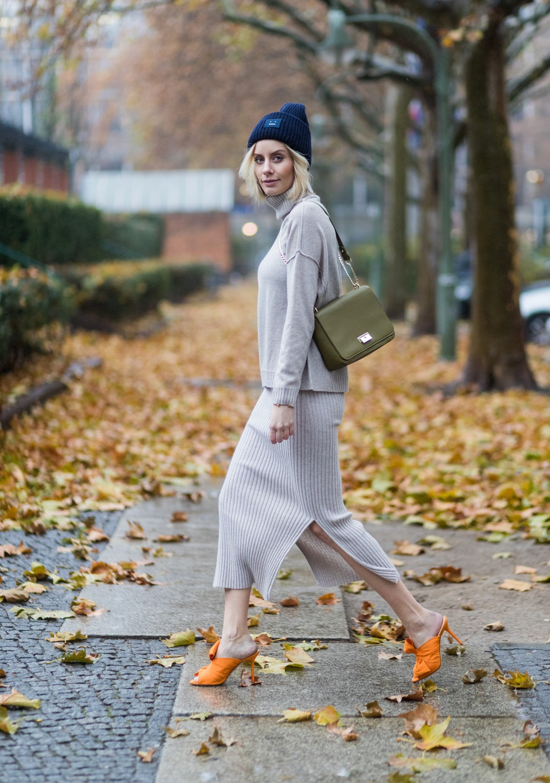 BERLIN, GERMANY - NOVEMBER 16: Lisa Hahnbueck (@lisarvd) wearing Allude Cashmere Turtle Neck Beige Melange, Allude Cashmere Knit Skirt Beige Melange, Aigner Lucy Bag in Moss Green, Charlotte Olympia Orange Ilona Silkmules with Bow / Bow Mules, navy Acne Studios Pansy Beanie Hat on November 16, 2016 in Berlin, Germany. (Photo by Christian Vierig/Getty Images) *** Local Caption *** Lisa Hahnbueck