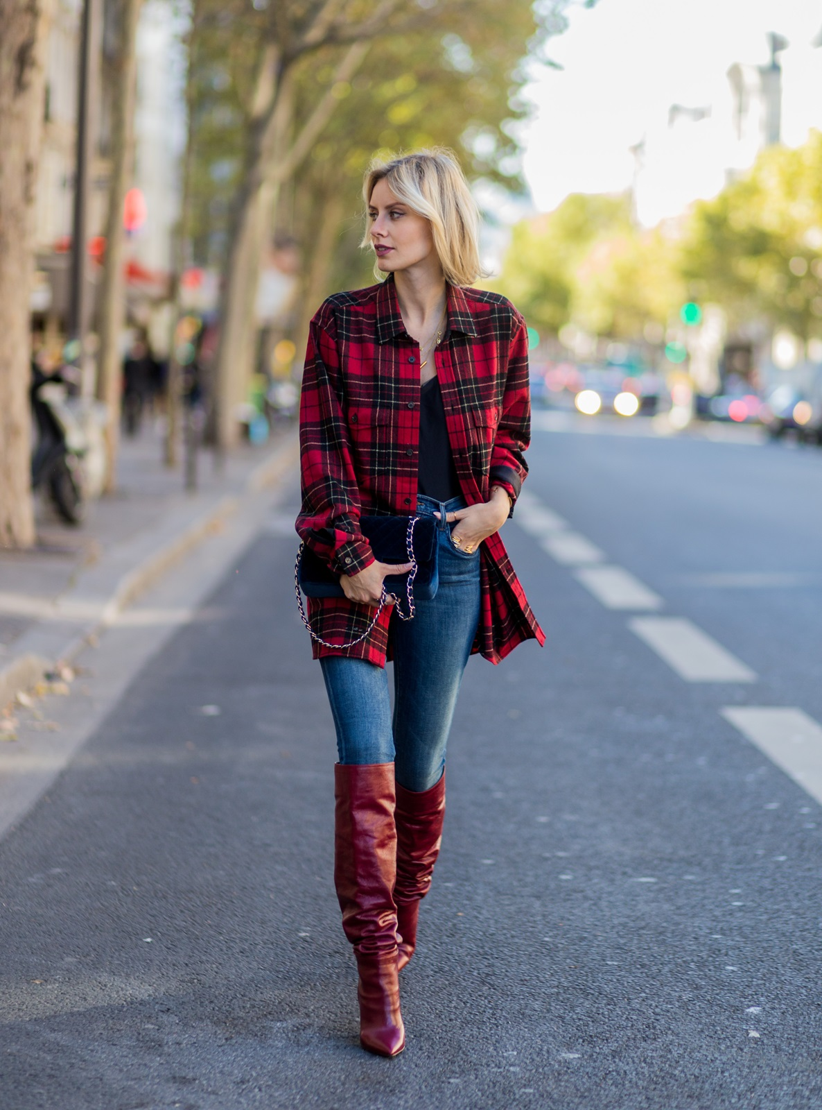 PARIS, FRANCE - OCTOBER 04: German fashion blogger Lisa Hahnbueck (@lisarvd) wearing Saint Laurent checked red Oversize Shirt, JBrand Highwaist Jeans, navy Chanel bag red Zara Overknees on October 4, 2016 in Paris, France. (Photo by Christian Vierig/Getty Images) *** Local Caption *** Lisa Hahnbueck