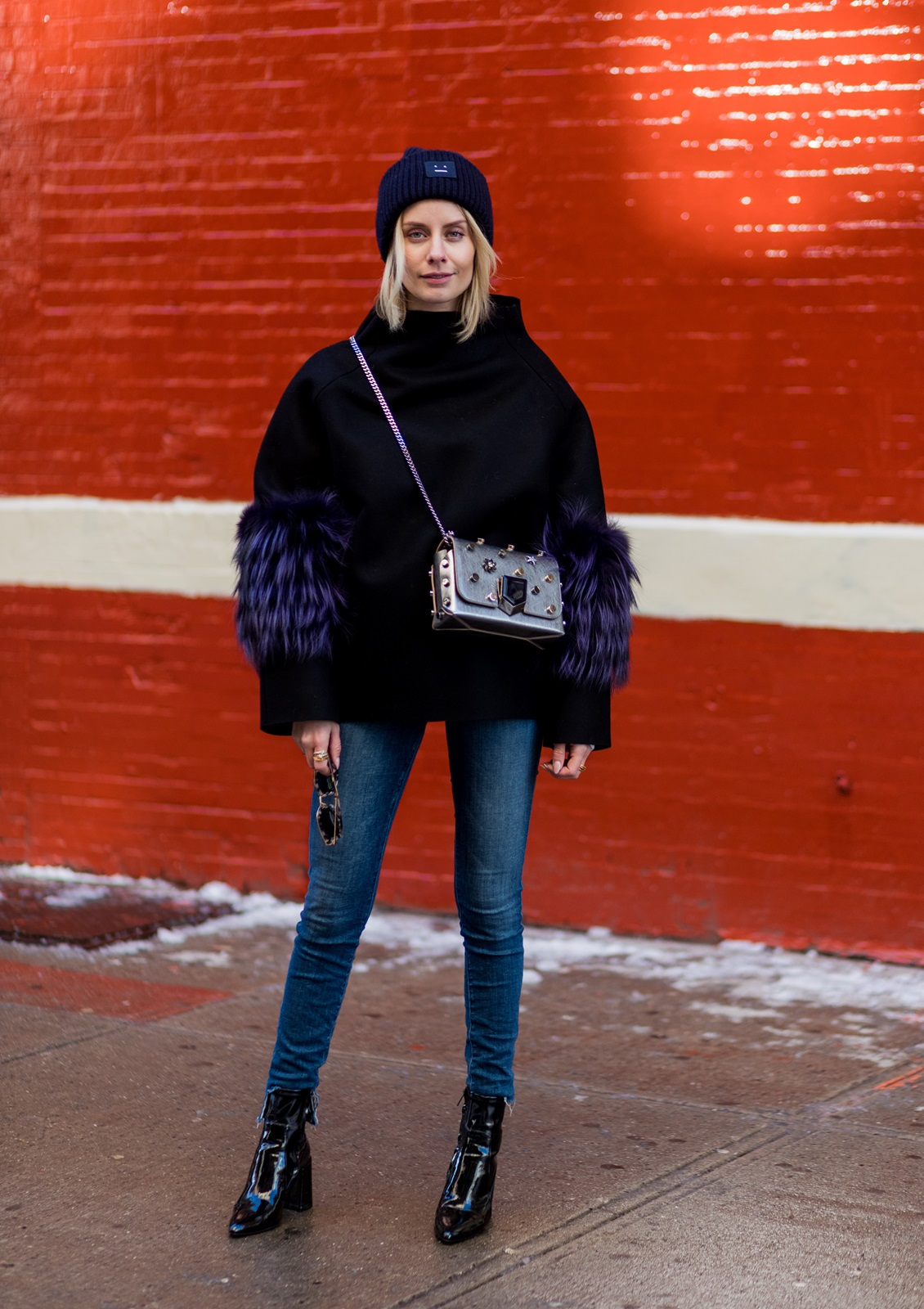 NEW YORK, NY - FEBRUARY 10: Lisa Hahnbueck wearing SAKS POTTS Black Felt Fox Fur Bille Jumper, JBRAND Carolina HIGHWAIST JEANS, ACNE PANSY BEANIE, MANGO NAPLACK BOOTS, JIMMY CHOO LOCKETT BAG on February 10, 2017 in New York City. (Photo by Christian Vierig/Getty Images) *** Local Caption *** Lisa Hahnbueck