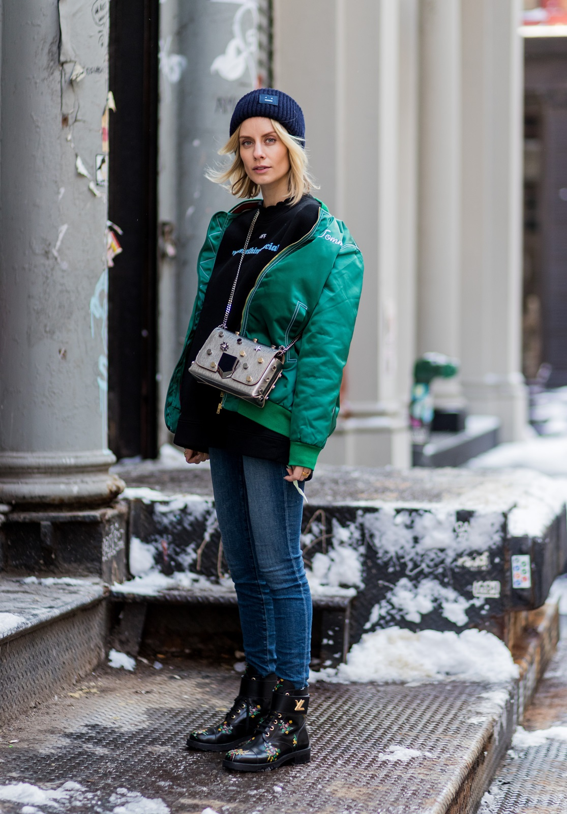 NEW YORK, NY - FEBRUARY 10: Lisa Hahnbueck wearing HILFIGER COLLECTION OVERSIZED BOMBER JACKET, OFF WHITE PRINTED COTTON SWEATSHIRT, JIMMY CHOO LOCKETT BAG, ACNE PANSY BEANIE, LOUIS VUITTON FLACHER WONDERLAND RANGER BOOT on February 10, 2017 in New York City. (Photo by Christian Vierig/Getty Images) *** Local Caption *** Lisa Hahnbueck
