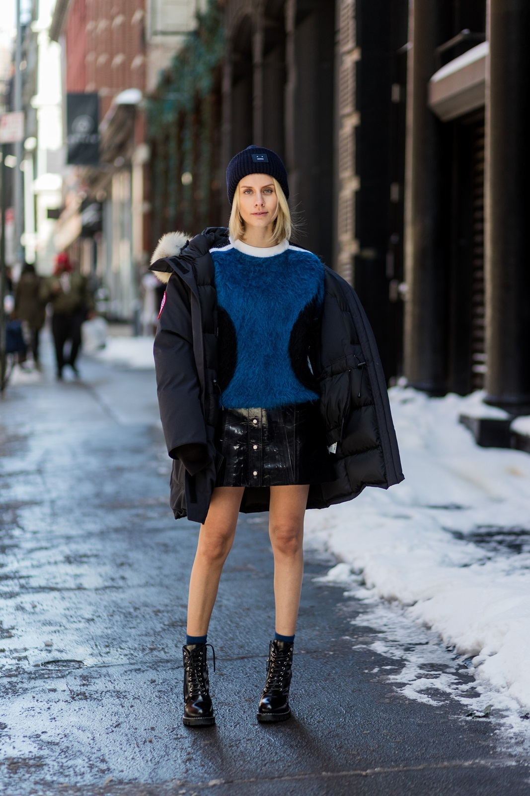 NEW YORK, NY - FEBRUARY 10: Lisa Hahnbueck wearing Canada Goose Resolute Parka, Louis Vuitton RTW Mohair Knit, Naplack And Leather Miniskirt, Louis Vuitton STAR TRAIL ANKLE BOOT, ACNE PANSY BEANIE on February 10, 2017 in New York City. (Photo by Christian Vierig/Getty Images) *** Local Caption *** Lisa Hahnbueck